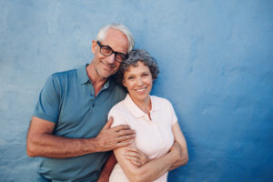 Smiling mature couple standing together